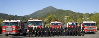 Engines and firefighters in front of Mt. Tam